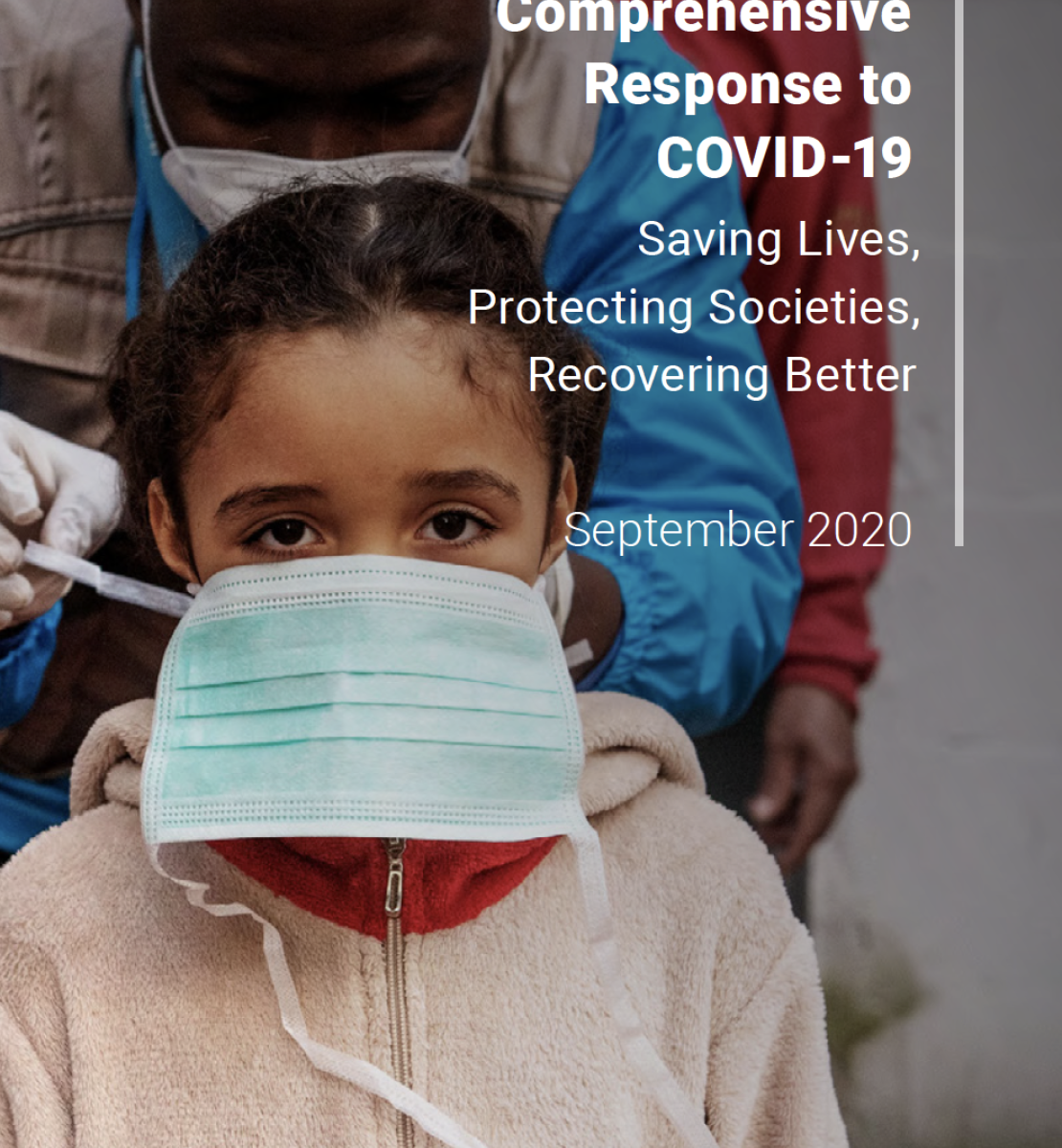 Cover shows a UN staff member helping to place a protective face mask on a young girl
