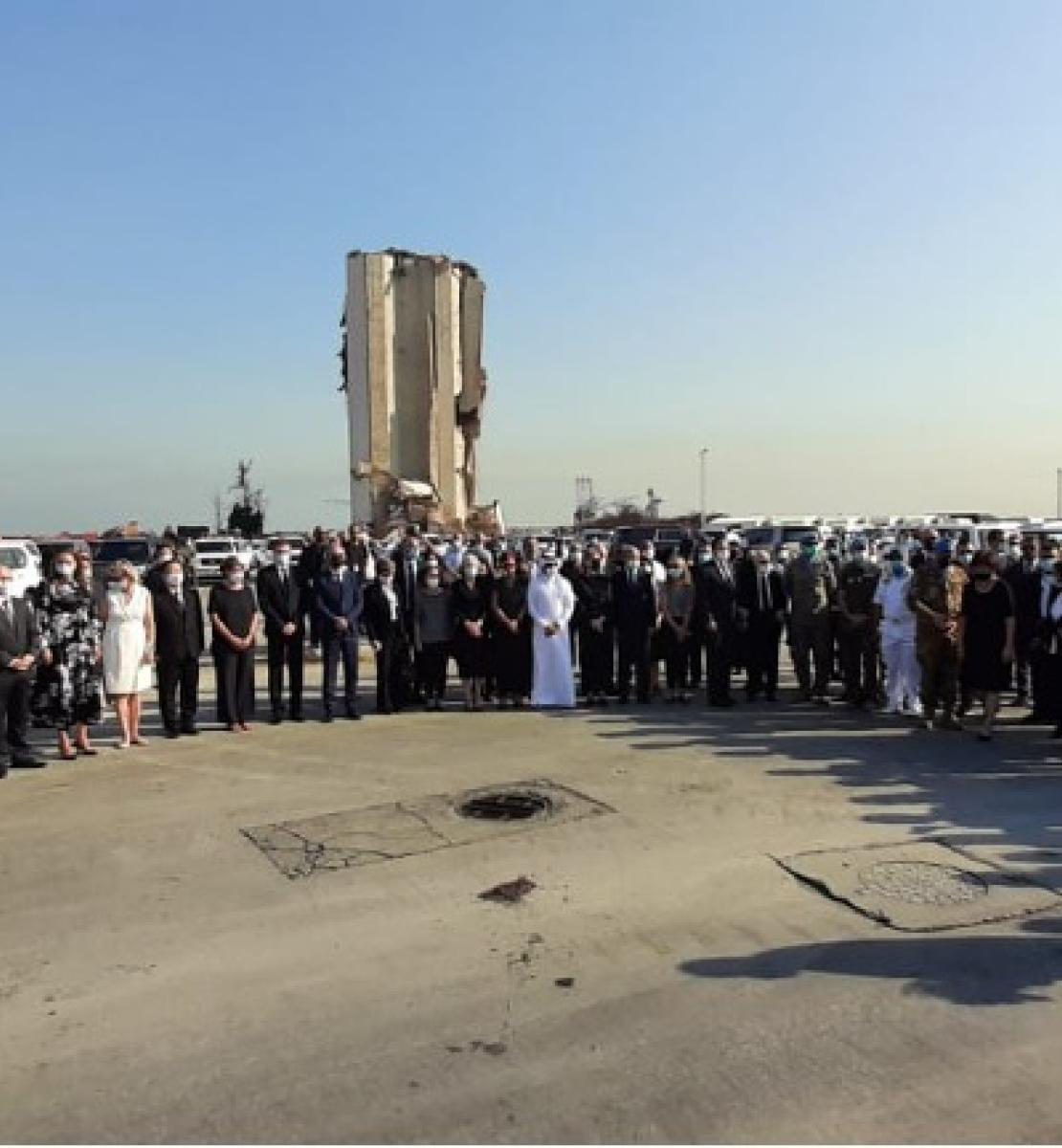 United Nations staff and Diplomatic Corps in Lebanon stand side by side outside as they observe a moment of silence in honour of the people who died in the Beirut port explosions.
