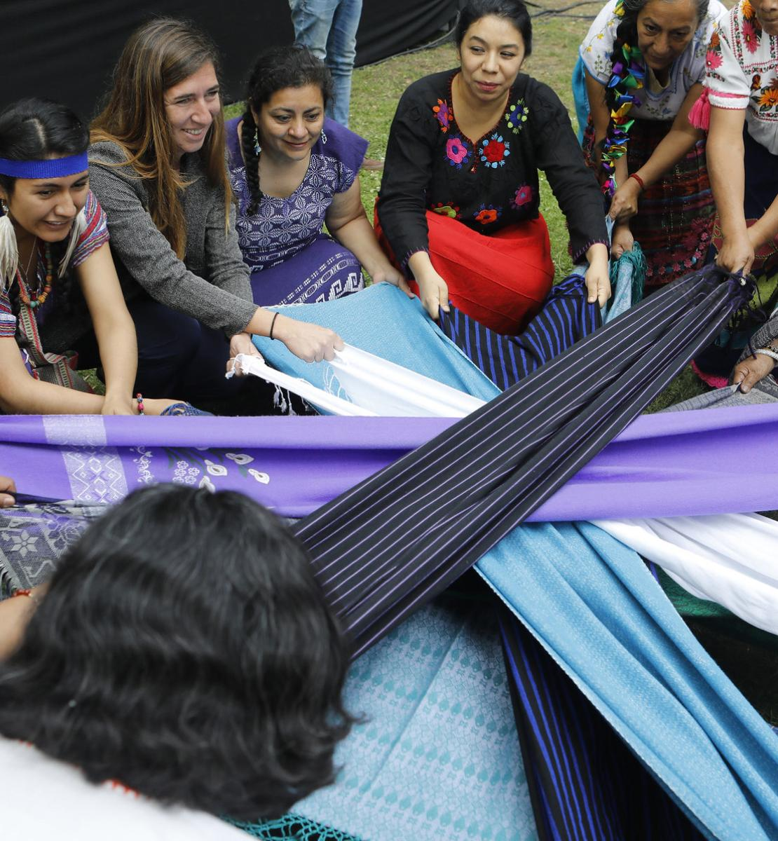 Indigenous women's group members hold several pieces of fabric in a circular shape. It's part of a performance for the opening ceremony to kick off the Generation Equality Forum in Mexico. The ceremony was held at the Complejo Cultural Los Pinos in Mexico City on 29 March 2021.